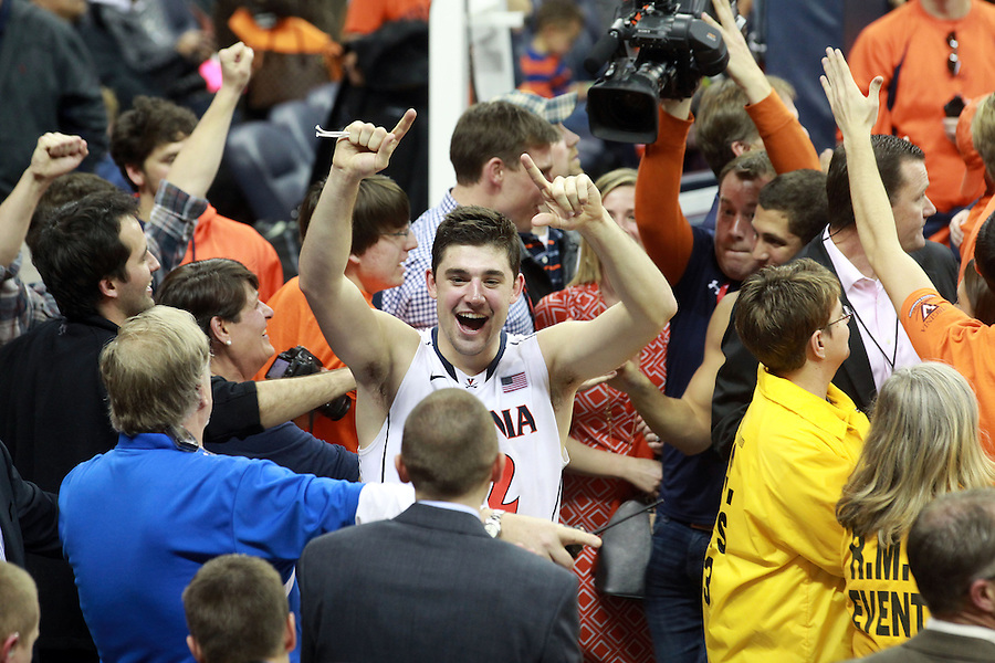 Virginia guard Joe Harris (12)celebrates with fans after winning the ACC title by defeating Syracuse 75-56 Saturday March 1, 2014 during an NCAA basketball game in Charlottesville, VA. Photo/Andrew Shurtleff