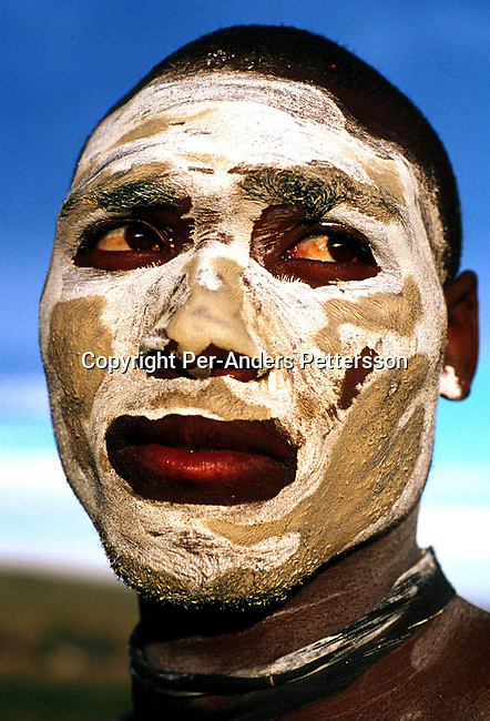 dicuinit00014 Culture. Inititiation TSHATSHU, SOUTH AFRICA AUGUST 21:  Gixana Sekhele, age 18, a Xhosa boy, has just painted his face with clay as he is going trough a traditional manhood ceremony on August 21, 2000 in Tshatshu, South Africa. The ceremony lasts for about six weeks starting with a circumcision.  The wound has to be healed in a natural way and the boys are guided by traditional healers and elders during the ceremony, which is to prepare them for adulthood. Former South Africa president Nelson Mandela went trough the same ceremony when he was young. The last years has seen an increase in botched circumcisions because some operators of initiation schools use unsanitary equipment and the risk of being infected by HIV. .(Photo: Per-Anders Pettersson/ Getty Images).