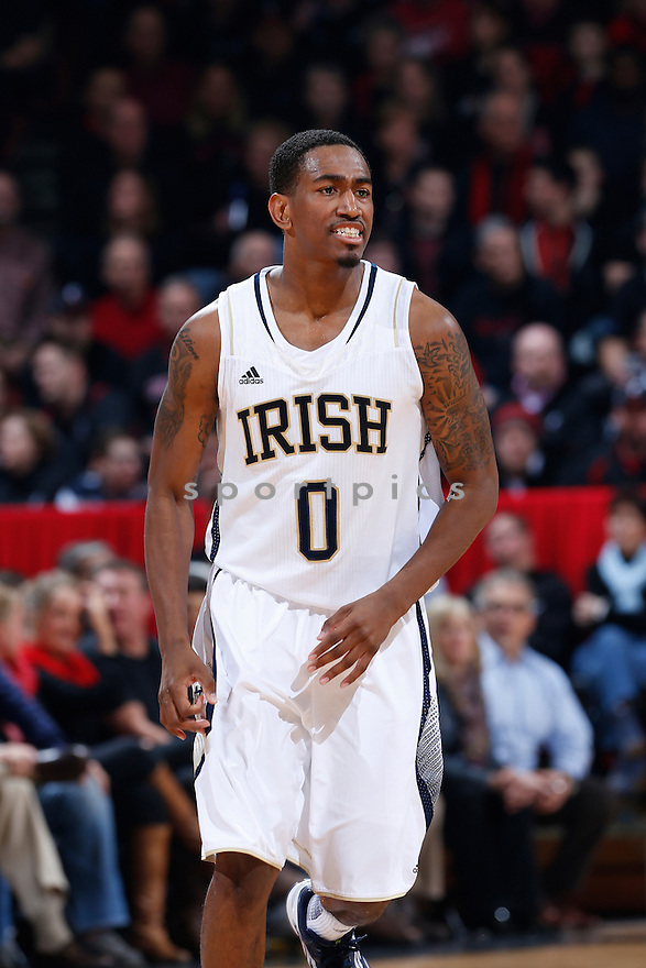 CINCINNATI, OH - JANUARY 7: Eric Atkins #0 of the Notre Dame Fighting Irish reacts after scoring a basket against the Cincinnati Bearcats during the game at Fifth Third Arena on January 7, 2013 in Cincinnati, Ohio. Notre Dame won 66-60. Eric Atkins