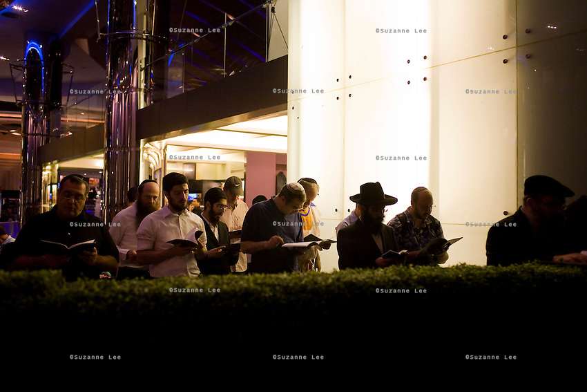 Rabbi Wilhelm (2nd from left) joins Jewish residents of Thailand and travellers alike to take time off to pray in a corner during the Chanuka celebrations organised by Chabad Bangkok on 13th December 2009, at Paragon Mall's IMAX theater, Bangkok, Thailand..Photo by Suzanne Lee / For Chabad Lubavitch
