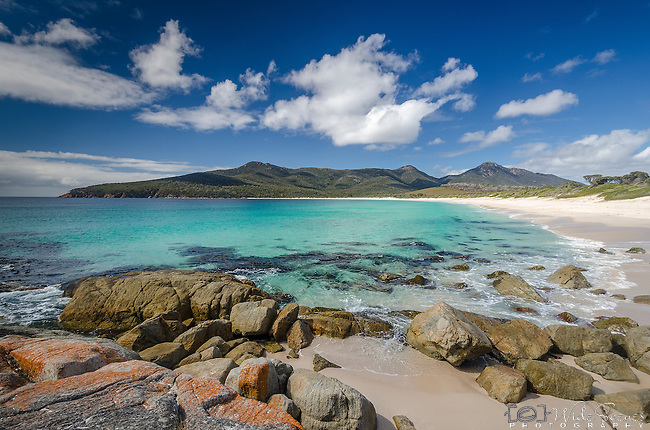 Panorama of the pristine beach at Wineglass Bay in Tasmania, Australia. This is Tasmania's most famous beach and images from the lookout feature in practically every brochure for the state. It can only be accessed by a steep walking track.