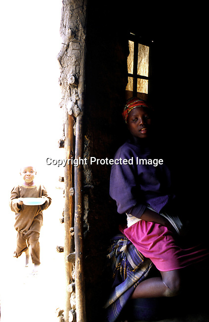 Sethu Shenge 15 years old, on November 27, 1999 and the oldest daughter of Margrette Shenge who is living with Aids in Nqbeni, Natal, South Africa. Siwe, 5, Her little brother is also infected. Sethu is not infected but has a boyfriend that lives in Durban. .(Photo: Per-Anders Pettersson/ Liaison Agency)