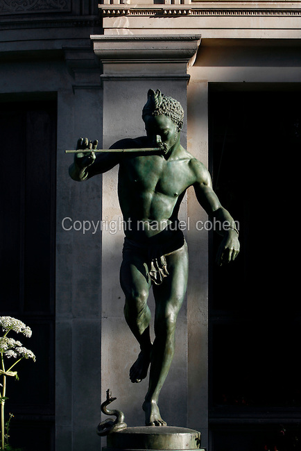 General view of the statue called Le Charmeur de serpent or Le Danseur Nubien (The snake charmer) lit by the early morning light, created by Baron Charles-Arthur Bourgeois circa 1868 and located in the Menagerie of Jardin des Plantes, at the Reptile house (galerie des Reptiles) built by Jules Andr» from 1870 to 1874, Paris, 5th arrondissement, France. Founded in 1794 by Jacques Henri Bernardin de Saint-Pierre, the Menagerie of Jardin des Plantes became the largest exotic animal collection in Europe in the 19th century and is the second oldest public zoo in the world. Picture by Manuel Cohen