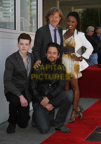 Cameron Monaghan, Justin Chatwin, William H Macy, Shanola Hampton.Felictiy Huffman And William H. Macy Hollywood Walk Of Fame Induction Ceremony Held At On the Walk of Fame, Hollywood, California, USA.  .March 7th, 2012.full length black suit leather jacket blazer white yellow print dress kneeling .CAP/ADM/KB.©Kevan Brooks/AdMedia/Capital Pictures.
