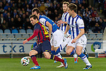 Real Sociedad's Mikel Gonzalez (c-l), David Zurutuza (c-r) and Jon Gaztanaga (r) and FC Barcelona's Leo Messi (l) during La Copa match.February 12,2014. (ALTERPHOTOS/Mikel)