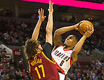 01/15/13--Portland Trail Blazers point guard Damian Lillard (0) shoots an off balance shot against Cleveland Cavaliers center Anderson Varejao (17) in the first half at Moda Center.<br />