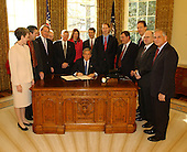 United States President George W. Bush pauses before signing the Controlling the Non-Solicited Pornography and Marketing Act of  2003, which establishes a framework of administrative, civil and criminal tools to help America's consumers, businesses and families combat SPAM, in the Oval Office in Washington, DC on December 16, 2003. Pictured with the President are from left to right: United States Representative Heather Wilson, (Republican of New Mexico); Garry Betty, President and CEO of Earthlink; United States Representative Edward Markey (Democrat of Massachusetts); United States Representative Rick Boucher (Democrat of Virginia); United States Senator Conrad Burns (Republican of Montana); United States Representative Melissa Hart (Republican of Pennsylvania); United States Senate Majority Leader Bill Frist (Republican of Tennessee); United States Senator Ron Wyden (Democrat of Oregon); United States Representative Chris Cannon (Republican of Utah); Jonathan Miller, Chairman and CEO of America Online; Maynard Webb, Chief Operating Officer of eBay; and United States Representative Gene Green (Democrat of Texas).<br /> Mandatory Credit: Tina Hager / White House via CNP