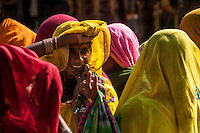 A lady peeps through her veil at Pushkar Fair.  Rajasthan, India.