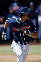 Michael Lorenzen #55 of the Cal State Fullerton Titans runs to first base against the Texas A&M Aggies at Goodwin Field on March 10, 2013 in Fullerton, California. (Larry Goren/Four Seam Images)