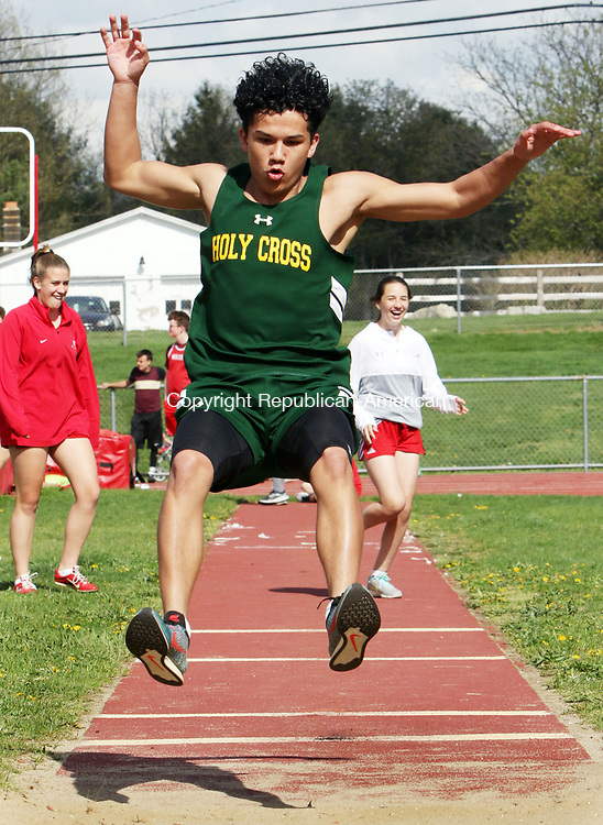 WOLCOTT CT. 05 May 2017-050217SV16-Shawn Austin, 14, of Holy Cross competes in the long jump during an NVL track meet against Sacred Heart and Wolcott High in Wolcott Tuesday.<br /> Steven Valenti Republican-American