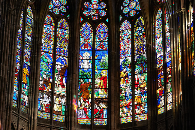 Medieval Gothic stained glass window showing  scenes from the Martyrdom of Saint Denis.  The Gothic Cathedral Basilica of Saint Denis ( Basilique Saint-Denis ) Paris, France. A UNESCO World Heritage Site.