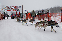 Jeff Holt Jr. of North Pole, AK leaves the start line of the 2009 Junior Iditarod on Knik Lake on Saturday Februrary 28, 2009.