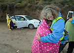 Lisbeth Sagen Lundin, a volunteer from Norway, hugs a frightened Syrian refugee on a beach near Molyvos, on the Greek island of Lesbos, on October 30, 2015. The woman was on a boat full of refugees that traveled to Lesbos from Turkey. The boat was provided by Turkish traffickers to whom the refugees paid huge sums to arrive in Greece. Lundin is one of hundreds of volunteers on the island who receive the refugees and provide them with warm clothing and medical care before they continue their journey toward western Europe.