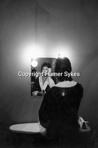 "Paul and Linda McCartney Wings Tour 1975. Paul in dressing room  fixing hair in mirror before going on stage. Bristol, England. The photographs from this set were taken in 1975. I was on tour with them for a children's ""Fact Book"". This book was called, The Facts about a Pop Group Featuring Wings. Introduced by Paul McCartney, published by G.Whizzard. They had recently recorded albums, Wildlife, Red Rose Speedway, Band on the Run and Venus and Mars. I believe it was the English leg of Wings Over the World tour. But as I recall they were promoting,  Band on the Run and Venus and Mars in particular."
