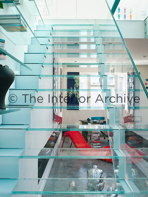A view through the glass staircase into the home office area at the front of the house