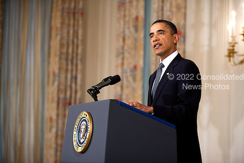 United States President Barack Obama speaks about the shooting of U.S. Representative Gabrielle Giffords (Democrat of Arizona) at the White House in Washington, D.C., U.S., on Saturday, January 8, 2011. Giffords, who is in critcal condition, was one of 18 shot during a constituant meeting in Tucson, Arizona. .Credit: Joshua Roberts / Pool via CNP