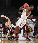 SIOUX FALLS, SD - MARCH 6:  Akilah Sims #30 of IUPUI trips over defender Ellie Brecht #34 of Omaha in the 2016 Summit League Tournament. (Photo by Dick Carlson/Inertia)