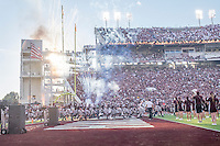 Game Day: MSU Football versus South Carolina.<br /> Football team runs out to fireworks<br />  (photo by Robert Lewis / &copy; Mississippi State University)