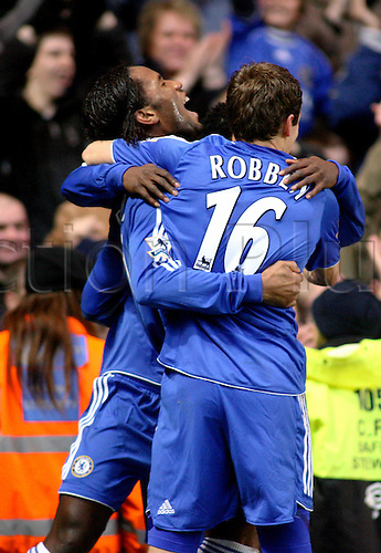 10 February 2007: Chelsea striker Didier Drogba celebrates his late goal with team mates during the Premiership game between Chelsea and Middlesbrough, played at Stamford Bridge. Chelsea won the match 3-0. Photo: Actionplus....070210 football soccer player joy celebration