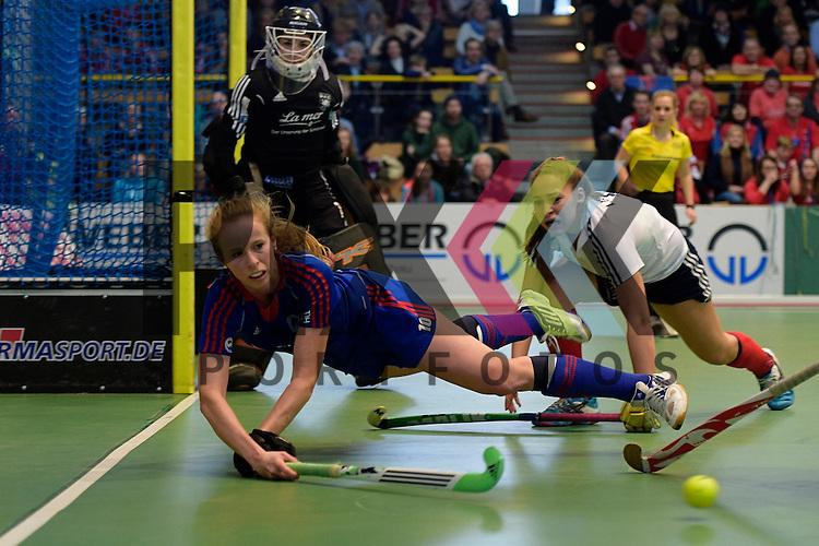 GER - Luebeck, Germany, February 07: During the 1. Bundesliga Damen indoor hockey final match at the Final 4 between Mannheimer HC (blue) and Duesseldorfer HC (white) on February 7, 2016 at Hansehalle Luebeck in Luebeck, Germany. Final score 6-4 after shootout.  Greta Lyer #10 of Mannheimer HC in action<br /> <br /> Foto &copy; PIX-Sportfotos *** Foto ist honorarpflichtig! *** Auf Anfrage in hoeherer Qualitaet/Aufloesung. Belegexemplar erbeten. Veroeffentlichung ausschliesslich fuer journalistisch-publizistische Zwecke. For editorial use only.