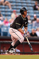 Omaha Storm Chasers first baseman Matt Fields (15) at bat during a game against the Nashville Sounds on May 19, 2014 at Herschel Greer Stadium in Nashville, Tennessee.  Nashville defeated Omaha 5-4.  (Mike Janes/Four Seam Images)