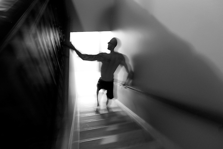 It's close to midnight, and a woozy George Sullivan walks down the stairs from his Brick apartment to head outside and cool off after he endured a special epsom salt bath that resulted in a 13-pound loss in body weight as he gets ready for his MMA title fight, which was less than 48 hours away in Atlantic City.