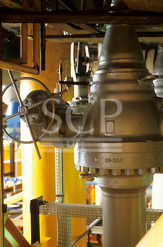 Campos Basin, Brazil. Valve on a Petrobras marine production oil rig painted yellow.