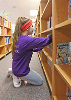 Maggie Gollnick helps out in the library at Our Lady of Grace School in Noblesville.