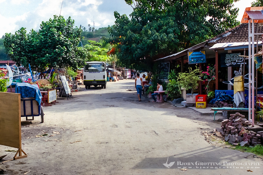 Bali, Karangasem, Padangbai. This small street that runs parallell to the beach.