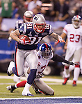 New England Patriots tight end Aaron Hernandez (81) scores a touchdown during the NFL Super Bowl XLVI football game against the New York Giants on Sunday, Feb. 5, 2012, in Indianapolis. The Giants won 21-17 (AP Photo/David Stluka)...