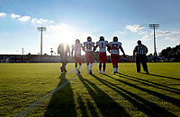 Photo by Randy Litzinger<br /> <br /> Liberty's captains walk hand in hand to midfield for the coin toss. Liberty defeated Brentsville District 29-8 on 8-24-18 at BDHS.