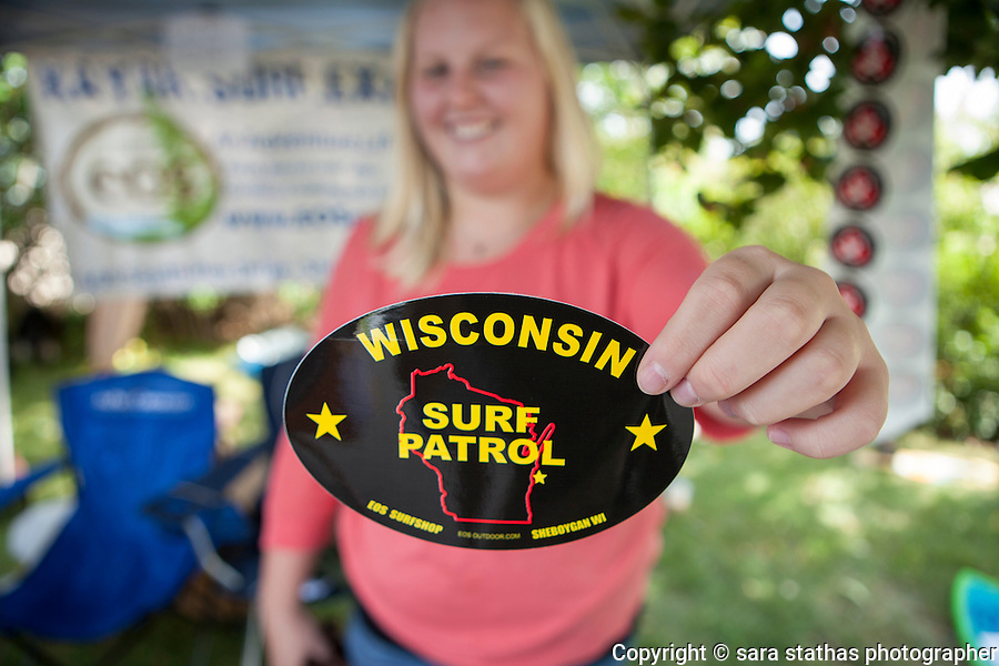A local surf shop sells fresh water surf themed memorabilia at the 25th annual Dairland Surf Classic in Sheboygan, Wisconsin.