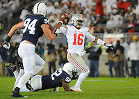22 October 2016:  Penn State DT Curtis Cothran (52) hits Ohio State QB J.T. Barrett (16) as he throws. The Penn State Nittany Lions upset the #2 ranked Ohio State Buckeyes 24-21 at Beaver Stadium in State College, PA. (Photo by Randy Litzinger/Icon Sportswire)