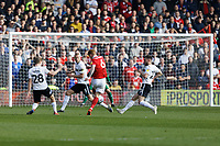 Jack Colback of Nottingham Forest takes a shot during the Sky Bet Championship match between Nottingham Forest and Swansea City at City Ground, Nottingham, England, UK. Saturday 30 March 2019