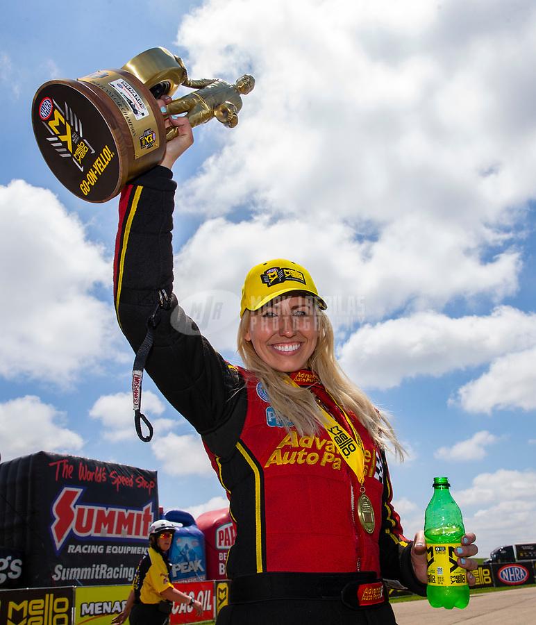 May 21, 2018; Topeka, KS, USA; NHRA funny car driver Courtney Force celebrates after winning the Heartland Nationals at Heartland Motorsports Park. Mandatory Credit: Mark J. Rebilas-USA TODAY Sports