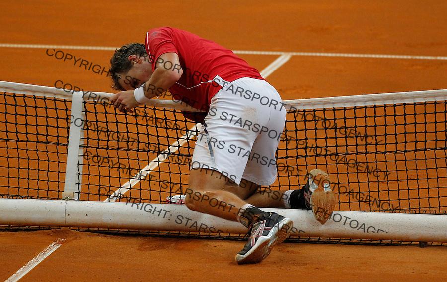 Tennis Tenis<br /> Davis Cup semifinal polufinale<br /> Serbia v Canada<br /> Janko Tipsarevic v Vasek Pospisil<br /> Janko Tipsarevic injured<br /> Beograd, 15.09.2013.<br /> foto: Srdjan Stevanovic/Starsportphoto &copy;