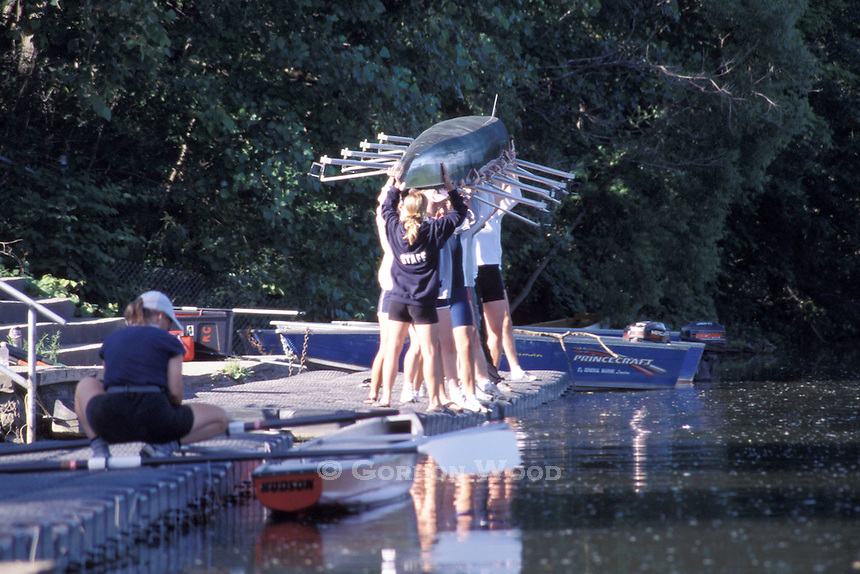 Sculling team preparing to launch rowboat