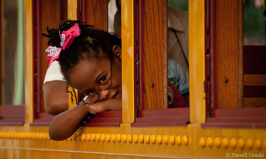 Photograph of a young girl taking a ride on the Memphis train trolley line.