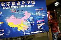 Sign at entry to Shanghai flagship store of successful French Carrefour supermarket, displaying a map of China showing the extent of the firm's reach in the country.