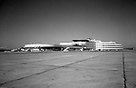 Pittsburgh PA 1953: View of the gates at the new Greater Pittsburgh Airport in 1953. In 1944, Allegheny County officials proposed to expand the military airport with the addition of a commercial passenger terminal in order to relieve the Allegheny County Airport, which was built in 1926 and whose capacity was quickly becoming insufficient to support the growing demand for air travel.  The new airport, christened as Greater Pittsburgh Airport opened on May 31, 1952. The first flight occurred on June 3, 1952.