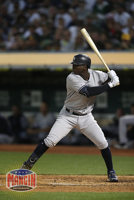 OAKLAND, CA - AUGUST 20:  Didi Gregorius #18 of the New York Yankees bats against the Oakland Athletics during the game at the Oakland Coliseum on Tuesday, August 20, 2019 in Oakland, California. (Photo by Brad Mangin)