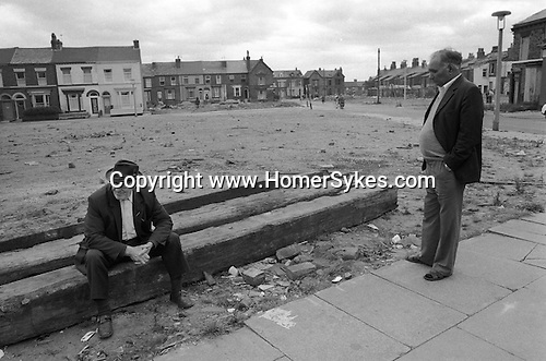 Toxteth, Liverpool. 1981<br /> Unemployed men pass the time of day, bad housing; poverty and deprivation was a common feature of Liverpool 8. <br /> <br /> <br /> Mr John Hopkins.