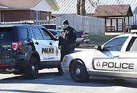 NWA Democrat-Gazette/DAVID GOTTSCHALK Members of the Springdale Police Department stage Friday, March 15, 2019 at the Applegate Apartment complex in Springdale before taking Dekota Harvey, 22, into custody around 10;30 a.m. at the apartment complex. Fayetteville police said Harvey, 22, was wanted in connection with a Thursday night shooting that left one person dead and a second hospitalized. The shooting happened in the 900 block of North Leverett Avenue, according to police. Officers were called to a report of a disturbance in the area at 9:12 p.m. An ambulance was dispatched to the area at 9:16 p.m.