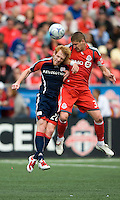 23 May 09: New England Revolution defender Pat Phelan #28 and Toronto FC midfielder Carl Robinson #33 in action during a game between the New England Revolution and Toronto FC.Toronto FC won 3-1.