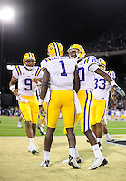 Sept. 5, 2009; Seattle, WA, USA; LSU Tigers wide receiver (1) Brandon LaFell is congratulated by wide receiver (80) Terrance Toliver and quarterback (9) Jordan Jefferson after scoring a touchdown against the Washington Huskies at Husky Stadium. LSU defeated Washington 31-23. Mandatory Credit: Mark J. Rebilas-
