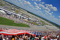 Apr 25, 2009; Talladega, AL, USA; NASCAR Nationwide Series fans hold an American flag during the national anthem prior to the Aarons 312 at the Talladega Superspeedway. Mandatory Credit: Mark J. Rebilas-
