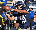 Nevada receiver Wyatt Demps (19) makes a catch in front of San Jose State cornerback Andre Chachere (21) in the first half of an NCAA college football game in Reno, Nev. Saturday, Nov. 11, 2017. (AP Photo/Tom R. Smedes)