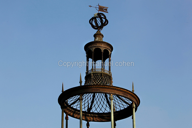 Low angle view of the Gloriette de Buffon (Buffon's Gazebo), one of the oldest iron structures in the world, built in 1788 by Edme Verniquet, sits on the peak of the Labyrinthe (Labyrinth) and is located in the Jardin des Plantes, Paris, 5th arrondissement, France. Founded in 1626 by Guy de La Brosse, Louis XIII's physician, the Jardin des Plantes, originally known as the Jardin du Roi, opened to the public in 1640. It became the Museum National d'Histoire Naturelle in 1793 during the French Revolution. Picture by Manuel Cohen