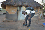 Taban Lual, 15, shines his shoes before going to school in the Rhino Refugee Camp in northern Uganda. As of April 2017, the camp held almost 87,000 refugees from South Sudan, and more people were arriving daily. About 1.8 million people have fled South Sudan since civil war broke out there at the end of 2013. About 900,000 have sought refuge in Uganda.