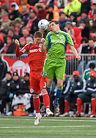 Sebastien LeToux (9) of the Seattle Sounders FC and Carl Robinson (33) of Toronto FC jump for a ball in MLS action at BMO Field on April 4, 2009.Seattle won 2-0.